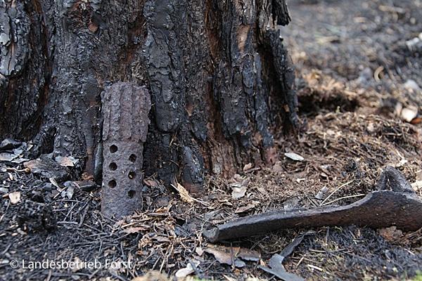 Überreste einer explodierten Granate